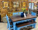 This is a 6' Santa Rita table painted and distressed in this Blue that is sure to brighten up your kitchen or dining room. You can get chairs all the way around or like shown with a bench on one side. This ever popular ensemble also comes in different colors such as white, gray and natural.