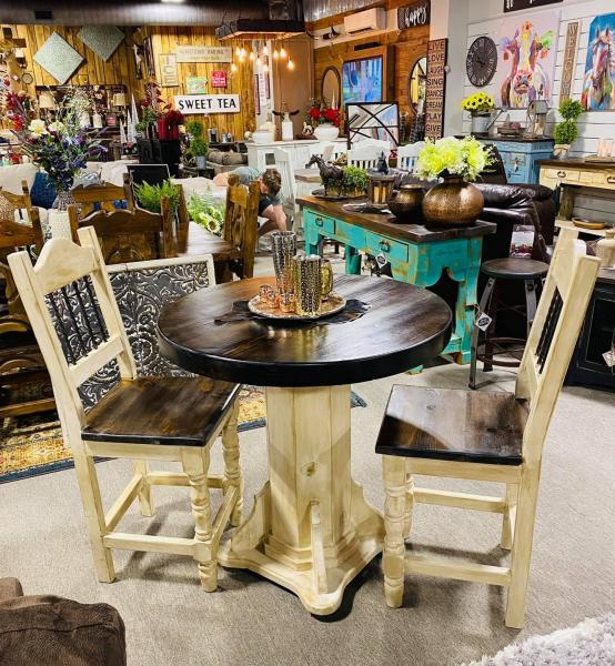 This round counter height table and chairs will make a perfect addition for a small eat in kitchen or breakfast nook, or maybe even in a game room or movie room. come on by our showroom and check this beauty out. You may call us anytime for pricing, availability and color options.